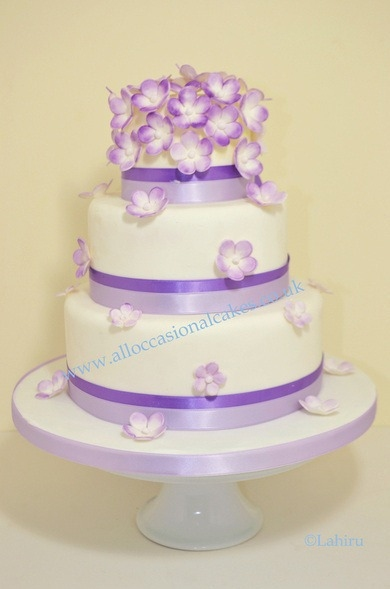 Purple blossoms wedding cake