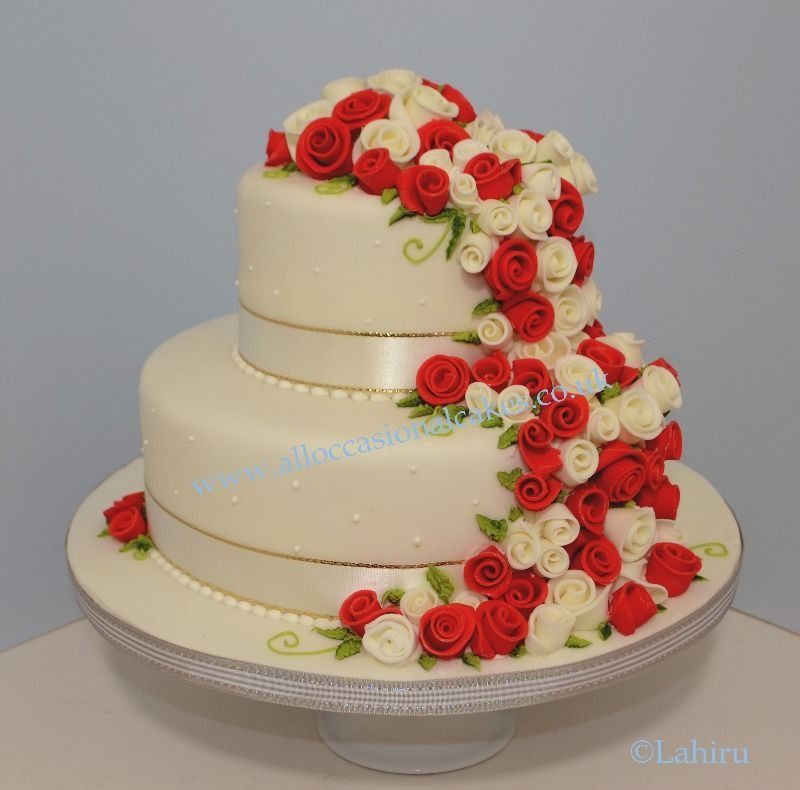 Red and Ivory Rose Buds Wedding Cake,  bristol wedding cakes, cakes pictures, magic wedding cakes,  uk cakes, uk wedding cakes, emersons green wedding cakes, cheap cakes, best cakes, international wedding cakes, international cakes, egg free cakes, egg less cakes, downend cakes, king cakes, downend wedding cakes, colourful cakes, all occasional cakes, cakes for all occasions, tasty wedding cakes, golden wedding cakes, sweet wedding cakes, anniversary cakes, sri lankan wedding,  wedding cakes, england wedding cakes, england cakes, birthday cakes, google cakes, winter cakes, snow cakes, topsy turvy cakes, cascade, cheap cakes, cheap wedding cakes, special wedding cakes, best cakes, uk, cakes, cake, cake makers, weddings, wedding, bristol, bristoluk, bath, bathuk, novelty cake, novelty cakes, unique cake, unique cakes, custom cake, custom cakes, birthday cake, birthday cakes, wedding cake, wedding cakes, corporate cake, corporate cakes, winning wedding cakes, winning cakes, yate wedding cakes, filton wedding cakes, clifton wedding cakes, winterbourne wedding cakes, London wedding cakes, royal wedding cakes, bristol wedding cakes, wedding cakes Bristol, wedding cake Bristol, Asian wedding cakes, indian wedding cakes, expensive cakes, expensive wedding cakes, rich wedding cakes, royal wedding cakes, rich cakes, gold wedding cakes, 24k wedding cakes, tasty wedding cakes, royal wedding cakes, queen wedding cakes, queen birthday cake, king's wedding cakes, Kings birthday cakes, prince wedding cakes, prince birthday cakes, best cakes, love cake, magic cakes, cake, fairy cakes, hot cakes, cupcakes, cupcake cakes, fondant cakes, cupcakes, my ace cakes of uk, cakes Sri Lanka, fab cakes, cakes sri lanka, south Gloucestershire, cake decoration, catering for weddings, Bristol birthday cakes, Bristol anniversary cakes, Kids birthday cakes Bristol, adult birthday cakes Bristol, cheap birthday cakes Bristol,  Asian cakes Bristol, Asian wedding cakes Bristol, indian wedding cake cakes Bristol indian cake bristol, cupcake Bristol, Santa cakes Bristol, seasonal cakes Bristol, hand bag cakes Bristol, indian cream cake Bristol, egg free wedding cakes Bristol, eggless cakes cake Bristol, Christmas cakes Bristol, car cakes Bristol, Lamborghini cakes Bristol, Bristol, piers, call piers, the art of sweet wedding cakes Bristol, boys birthday cakes Bristol, girls birthday cake bristol, emersons green birthday cakes, emersons green anniversary cakes, Kids birthday cakes emersons green, adult birthday cakes emersons green, cheap birthday cakes emersons green,  Asian cakes emersons green, Asian wedding cakes emersons green, indian wedding cake cakes emersons green indian cake emersons green, cupcake emersons green, Santa cakes emersons green, seasonal cakes emersons green, hand bag cakes emersons green, indian cream cake emersons green, egg free wedding cakes emersons green, eggless cakes cake emersons green, Christmas cakes emersons green, car cakes emersons green, Lamborghini cakes emersons green, emersons green, piers, call piers, the art of sweet wedding cakes emersons green, boys birthday cakes emersons green, girls birthday cake emersons green, downend birthday cakes, downend anniversary cakes, Kids birthday cakes downend, adult birthday cakes downend, cheap birthday cakes downend, Asian cakes downend, Asian wedding cakes downend, indian wedding cake cakes downend, indian cake downend, cupcake downend, Santa cakes downend, seasonal cakes downend, hand bag cakes downend, indian cream cake downend, egg free wedding cakes downend, eggless cakes cake downend, Christmas cakes downend, car cakes downend, Lamborghini cakes downend, downend, piers, call piers, the art of sweet wedding cakes downend, boys birthday cakes downend, girls birthday cake downend, Lahiru Peiris,