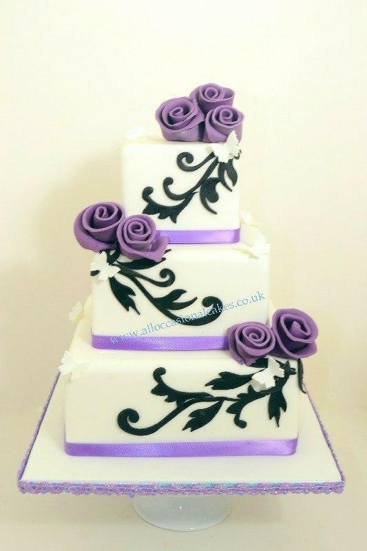 Lilac Roses and Black Scrolls Wedding Cake, bristol wedding cakes, cakes pictures, magic wedding cakes,  uk cakes, uk wedding cakes, emersons green wedding cakes, cheap cakes, best cakes, international wedding cakes, international cakes, egg free cakes, egg less cakes, downend cakes, king cakes, downend wedding cakes, colourful cakes, all occasional cakes, cakes for all occasions, tasty wedding cakes, golden wedding cakes, sweet wedding cakes, anniversary cakes, sri lankan wedding,  wedding cakes, england wedding cakes, england cakes, birthday cakes, google cakes, winter cakes, snow cakes, topsy turvy cakes, cascade, cheap cakes, cheap wedding cakes, special wedding cakes, best cakes, uk, cakes, cake, cake makers, weddings, wedding, bristol, bristoluk, bath, bathuk, novelty cake, novelty cakes, unique cake, unique cakes, custom cake, custom cakes, birthday cake, birthday cakes, wedding cake, wedding cakes, corporate cake, corporate cakes, winning wedding cakes, winning cakes, yate wedding cakes, filton wedding cakes, clifton wedding cakes, winterbourne wedding cakes, London wedding cakes, royal wedding cakes, bristol wedding cakes, wedding cakes Bristol, wedding cake Bristol, Asian wedding cakes, indian wedding cakes, expensive cakes, expensive wedding cakes, rich wedding cakes, royal wedding cakes, rich cakes, gold wedding cakes, 24k wedding cakes, tasty wedding cakes, royal wedding cakes, queen wedding cakes, queen birthday cake, king's wedding cakes, Kings birthday cakes, prince wedding cakes, prince birthday cakes, best cakes, love cake, magic cakes, cake, fairy cakes, hot cakes, cupcakes, cupcake cakes, fondant cakes, cupcakes, my ace cakes of uk, cakes Sri Lanka, fab cakes, cakes sri lanka, south Gloucestershire, cake decoration, catering for weddings, Bristol birthday cakes, Bristol anniversary cakes, Kids birthday cakes Bristol, adult birthday cakes Bristol, cheap birthday cakes Bristol,  Asian cakes Bristol, Asian wedding cakes Bristol, indian wedding cake 