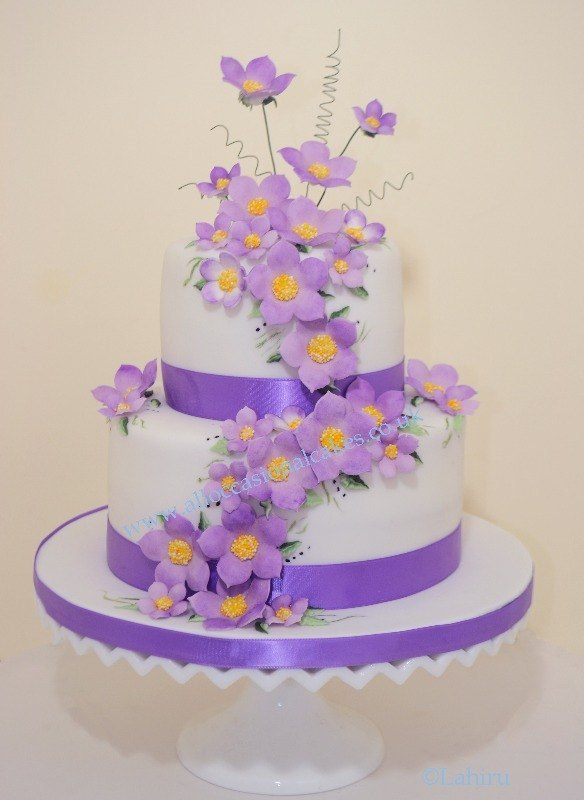 Purple Blossom Flow Wedding Cake, bristol wedding cakes, cakes pictures, magic wedding cakes,  uk cakes, uk wedding cakes, emersons green wedding cakes, cheap cakes, best cakes, international wedding cakes, international cakes, egg free cakes, egg less cakes, downend cakes, king cakes, downend wedding cakes, colourful cakes, all occasional cakes, cakes for all occasions, tasty wedding cakes, golden wedding cakes, sweet wedding cakes, anniversary cakes, sri lankan wedding,  wedding cakes, england wedding cakes, england cakes, birthday cakes, google cakes, winter cakes, snow cakes, topsy turvy cakes, cascade, cheap cakes, cheap wedding cakes, special wedding cakes, best cakes, uk, cakes, cake, cake makers, weddings, wedding, bristol, bristoluk, bath, bathuk, novelty cake, novelty cakes, unique cake, unique cakes, custom cake, custom cakes, birthday cake, birthday cakes, wedding cake, wedding cakes, corporate cake, corporate cakes, winning wedding cakes, winning cakes, yate wedding cakes, filton wedding cakes, clifton wedding cakes, winterbourne wedding cakes, London wedding cakes, royal wedding cakes, bristol wedding cakes, wedding cakes Bristol, wedding cake Bristol, Asian wedding cakes, indian wedding cakes, expensive cakes, expensive wedding cakes, rich wedding cakes, royal wedding cakes, rich cakes, gold wedding cakes, 24k wedding cakes, tasty wedding cakes, royal wedding cakes, queen wedding cakes, queen birthday cake, king's wedding cakes, Kings birthday cakes, prince wedding cakes, prince birthday cakes, best cakes, love cake, magic cakes, cake, fairy cakes, hot cakes, cupcakes, cupcake cakes, fondant cakes, cupcakes, my ace cakes of uk, cakes Sri Lanka, fab cakes, cakes sri lanka, south Gloucestershire, cake decoration, catering for weddings, Bristol birthday cakes, Bristol anniversary cakes, Kids birthday cakes Bristol, adult birthday cakes Bristol, cheap birthday cakes Bristol,  Asian cakes Bristol, Asian wedding cakes Bristol, indian wedding cake cakes Bristol indian cake bristol, cupcake Bristol, Santa cakes Bristol, seasonal cakes Bristol, hand bag cakes Bristol, indian cream cake Bristol, egg free wedding cakes Bristol, eggless cakes cake Bristol, Christmas cakes Bristol, car cakes Bristol, Lamborghini cakes Bristol, Bristol, piers, call piers, the art of sweet wedding cakes Bristol, boys birthday cakes Bristol, girls birthday cake bristol, emersons green birthday cakes, emersons green anniversary cakes, Kids birthday cakes emersons green, adult birthday cakes emersons green, cheap birthday cakes emersons green,  Asian cakes emersons green, Asian wedding cakes emersons green, indian wedding cake cakes emersons green indian cake emersons green, cupcake emersons green, Santa cakes emersons green, seasonal cakes emersons green, hand bag cakes emersons green, indian cream cake emersons green, egg free wedding cakes emersons green, eggless cakes cake emersons green, Christmas cakes emersons green, car cakes emersons green, Lamborghini cakes emersons green, emersons green, piers, call piers, the art of sweet wedding cakes emersons green, boys birthday cakes emersons green, girls birthday cake emersons green, downend birthday cakes, downend anniversary cakes, Kids birthday cakes downend, adult birthday cakes downend, cheap birthday cakes downend, Asian cakes downend, Asian wedding cakes downend, indian wedding cake cakes downend, indian cake downend, cupcake downend, Santa cakes downend, seasonal cakes downend, hand bag cakes downend, indian cream cake downend, egg free wedding cakes downend, eggless cakes cake downend, Christmas cakes downend, car cakes downend, Lamborghini cakes downend, downend, piers, call piers, the art of sweet wedding cakes downend, boys birthday cakes downend, girls birthday cake downend, Lahiru Peiris,