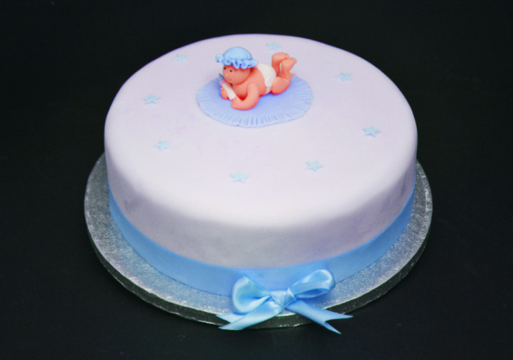christening cake with baby