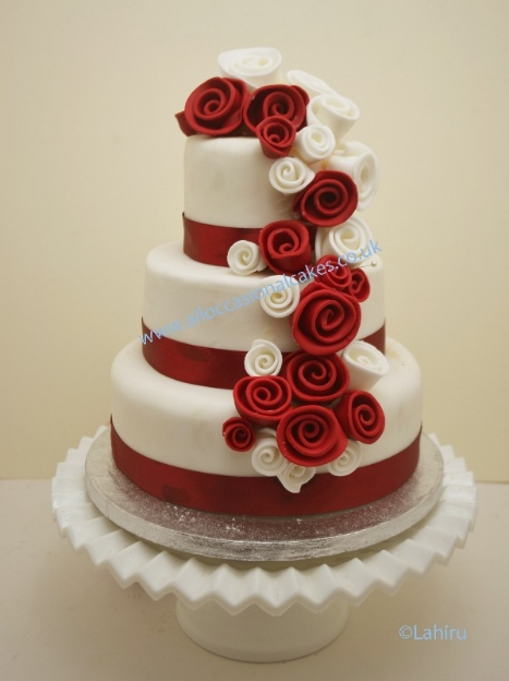Three Tier Wedding Cake With Cascading Roses