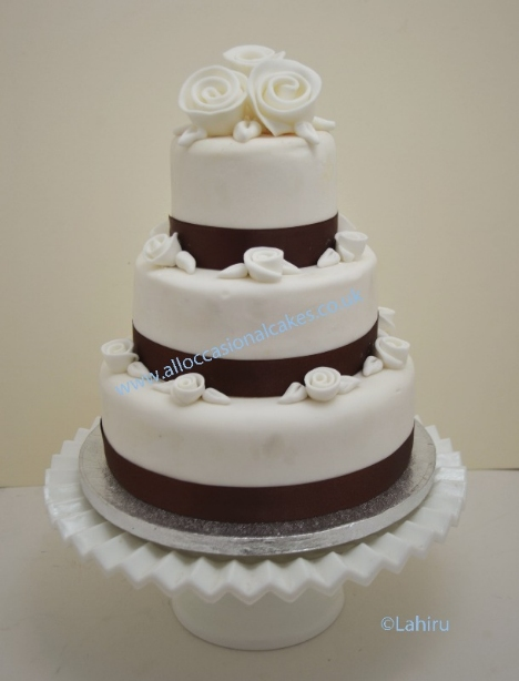 chocolate trims & roses wedding cake