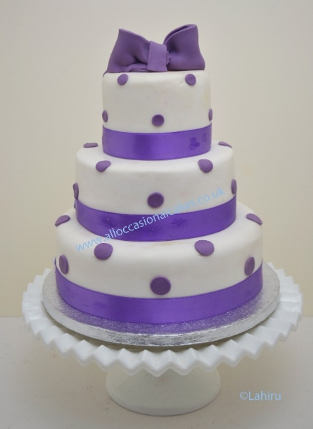 lilac colour with polka dots wedding cake 3 tier from £ 165, bristol wedding cakes, cakes pictures, magic wedding cakes,  uk cakes, uk wedding cakes, emersons green wedding cakes, cheap cakes, best cakes, international wedding cakes, international cakes, egg free cakes, egg less cakes, downend cakes, king cakes, downend wedding cakes, colourful cakes, all occasional cakes, cakes for all occasions, tasty wedding cakes, golden wedding cakes, sweet wedding cakes, anniversary cakes, sri lankan wedding,  wedding cakes, england wedding cakes, england cakes, birthday cakes, google cakes, winter cakes, snow cakes, topsy turvy cakes, cascade, cheap cakes, cheap wedding cakes, special wedding cakes, best cakes, uk, cakes, cake, cake makers, weddings, wedding, bristol, bristoluk, bath, bathuk, novelty cake, novelty cakes, unique cake, unique cakes, custom cake, custom cakes, birthday cake, birthday cakes, wedding cake, wedding cakes, corporate cake, corporate cakes, winning wedding cakes, winning cakes, yate wedding cakes, filton wedding cakes, clifton wedding cakes, winterbourne wedding cakes, London wedding cakes, royal wedding cakes, bristol wedding cakes, wedding cakes Bristol, wedding cake Bristol, Asian wedding cakes, indian wedding cakes, expensive cakes, expensive wedding cakes, rich wedding cakes, royal wedding cakes, rich cakes, gold wedding cakes, 24k wedding cakes, tasty wedding cakes, royal wedding cakes, queen wedding cakes, queen birthday cake, king's wedding cakes, Kings birthday cakes, prince wedding cakes, prince birthday cakes, best cakes, love cake, magic cakes, cake, fairy cakes, hot cakes, cupcakes, cupcake cakes, fondant cakes, cupcakes, my ace cakes of uk, cakes Sri Lanka, fab cakes, cakes sri lanka, south Gloucestershire, cake decoration, catering for weddings, Lahiru Peiris,