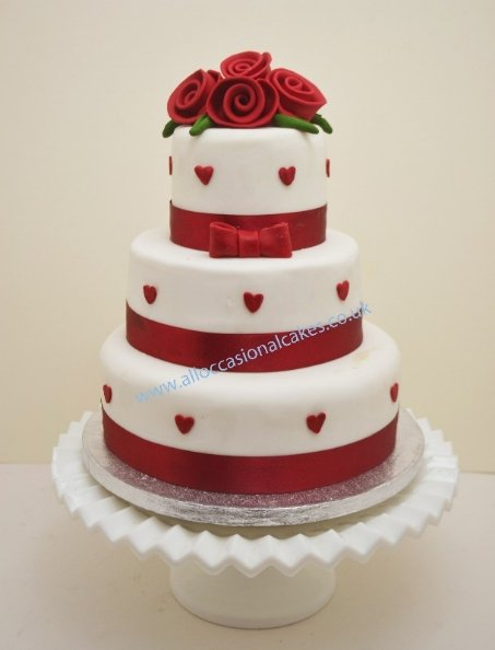 ruby roses with heartsr wedding cake 3 tier from £ 165, bristol wedding cakes, cakes pictures, magic wedding cakes,  uk cakes, uk wedding cakes, emersons green wedding cakes, cheap cakes, best cakes, international wedding cakes, international cakes, egg free cakes, egg less cakes, downend cakes, king cakes, downend wedding cakes, colourful cakes, all occasional cakes, cakes for all occasions, tasty wedding cakes, golden wedding cakes, sweet wedding cakes, anniversary cakes, sri lankan wedding,  wedding cakes, england wedding cakes, england cakes, birthday cakes, google cakes, winter cakes, snow cakes, topsy turvy cakes, cascade, cheap cakes, cheap wedding cakes, special wedding cakes, best cakes, uk, cakes, cake, cake makers, weddings, wedding, bristol, bristoluk, bath, bathuk, novelty cake, novelty cakes, unique cake, unique cakes, custom cake, custom cakes, birthday cake, birthday cakes, wedding cake, wedding cakes, corporate cake, corporate cakes, winning wedding cakes, winning cakes, yate wedding cakes, filton wedding cakes, clifton wedding cakes, winterbourne wedding cakes, London wedding cakes, royal wedding cakes, bristol wedding cakes, wedding cakes Bristol, wedding cake Bristol, Asian wedding cakes, indian wedding cakes, expensive cakes, expensive wedding cakes, rich wedding cakes, royal wedding cakes, rich cakes, gold wedding cakes, 24k wedding cakes, tasty wedding cakes, royal wedding cakes, queen wedding cakes, queen birthday cake, king's wedding cakes, Kings birthday cakes, prince wedding cakes, prince birthday cakes, best cakes, love cake, magic cakes, cake, fairy cakes, hot cakes, cupcakes, cupcake cakes, fondant cakes, cupcakes, my ace cakes of uk, cakes Sri Lanka, fab cakes, cakes sri lanka, south Gloucestershire, cake decoration, catering for weddings, Lahiru Peiris,