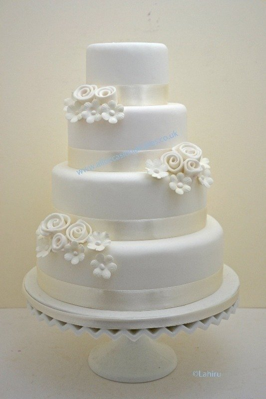 Ivory floral spray wedding cake