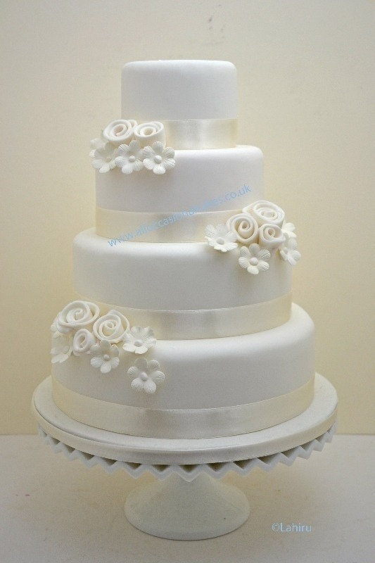 ivory floral spray wedding cake ( 4 tier from £ 290)