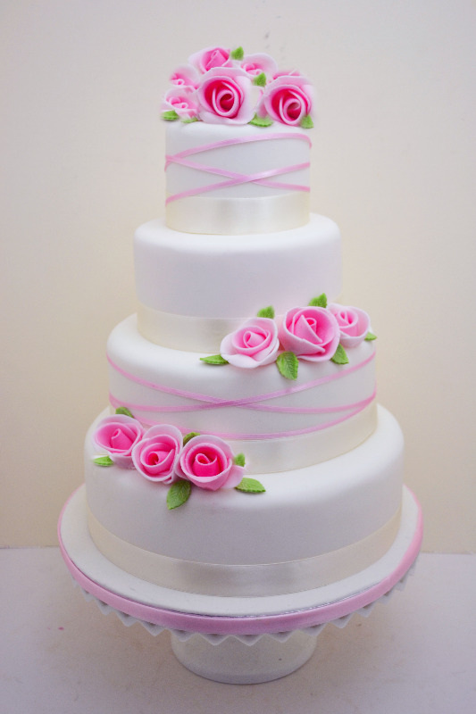 Pink floral spray wedding cake