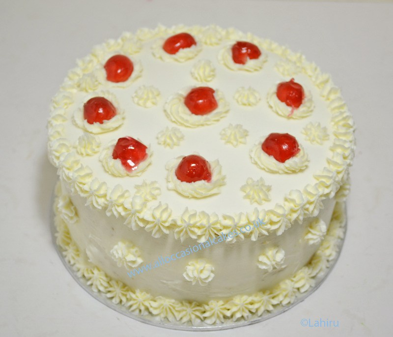 butter cream with charry birthday cake from
