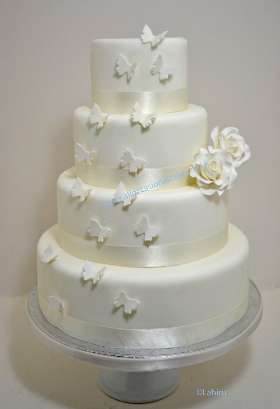 Ivory roses & butterflys wedding cake