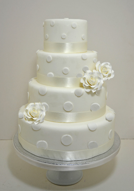 Ivory Roses and Polka Dots Wedding Cake, best bristol wedding cakes, egg free wedding cakes bristol, egg less wedding cakes bristol, bristol wedding cakes, cakes pictures, magic wedding cakes,  uk cakes, uk wedding cakes, emersons green wedding cakes, cheap cakes, best cakes, international wedding cakes, international cakes, egg free cakes, egg less cakes, downend cakes, king cakes, downend wedding cakes, colourful cakes, all occasional cakes, cakes for all occasions, tasty wedding cakes, golden wedding cakes, sweet wedding cakes, anniversary cakes, sri lankan wedding,  wedding cakes, england wedding cakes, england cakes, birthday cakes, google cakes, winter cakes, snow cakes, topsy turvy cakes, cascade, cheap cakes, cheap wedding cakes, special wedding cakes, best cakes, uk, cakes, cake, cake makers, weddings, wedding, bristol, bristoluk, bath, bathuk, novelty cake, novelty cakes, unique cake, unique cakes, custom cake, custom cakes, birthday cake, birthday cakes, wedding cake, wedding cakes, corporate cake, corporate cakes, winning wedding cakes, winning cakes, yate wedding cakes, filton wedding cakes, clifton wedding cakes, winterbourne wedding cakes, London wedding cakes, royal wedding cakes, bristol wedding cakes, wedding cakes Bristol, wedding cake Bristol, Asian wedding cakes, indian wedding cakes, expensive cakes, expensive wedding cakes, rich wedding cakes, royal wedding cakes, rich cakes, gold wedding cakes, 24k wedding cakes, tasty wedding cakes, royal wedding cakes, queen wedding cakes, queen birthday cake, king's wedding cakes, Kings birthday cakes, prince wedding cakes, prince birthday cakes, best cakes, love cake, magic cakes, cake, fairy cakes, hot cakes, cupcakes, cupcake cakes, fondant cakes, cupcakes, my ace cakes of uk, cakes Sri Lanka, fab cakes, cakes sri lanka, south Gloucestershire, cake decoration, catering for weddings, Lahiru Peiris,
