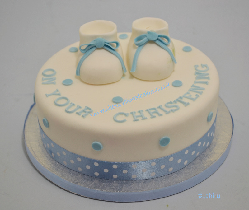 booties christening cake for baby boy