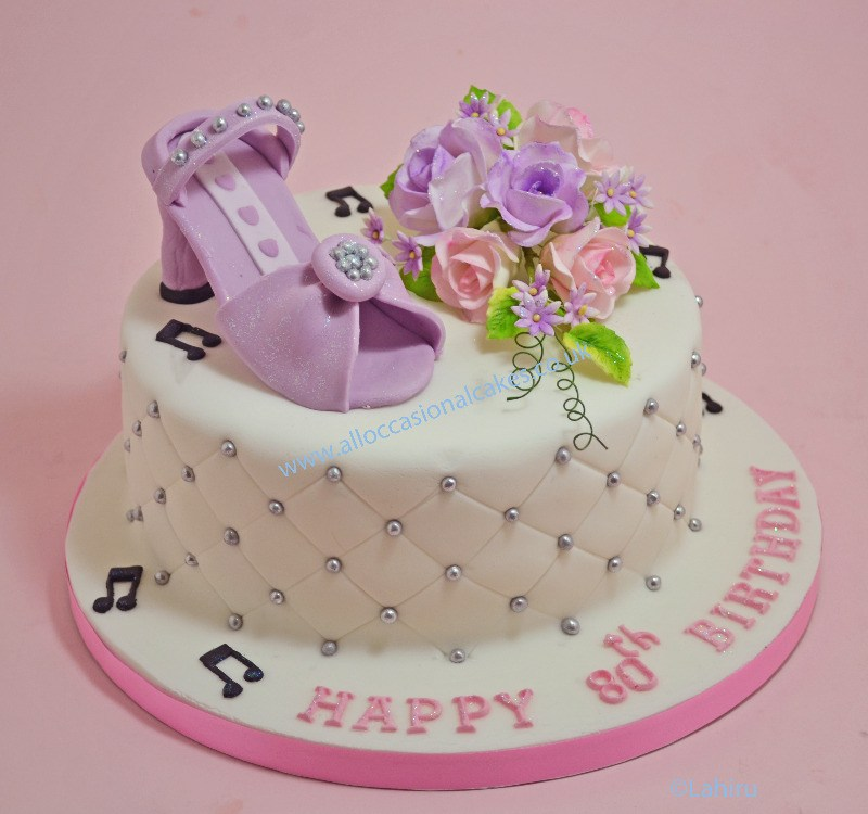 lilac shoe with flower spray cake