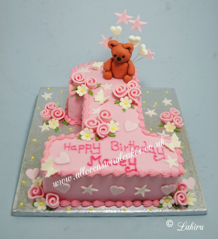 pink 1st birthday cake