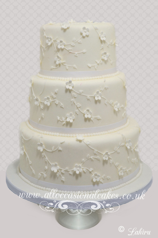 Trailing Blossom Wedding Cake, bristol wedding cakes, cakes pictures, magic wedding cakes,  uk cakes, uk wedding cakes, emersons green wedding cakes, cheap cakes, best cakes, international wedding cakes, international cakes, egg free cakes, egg less cakes, downend cakes, king cakes, downend wedding cakes, colourful cakes, all occasional cakes, cakes for all occasions, tasty wedding cakes, golden wedding cakes, sweet wedding cakes, anniversary cakes, sri lankan wedding,  wedding cakes, england wedding cakes, england cakes, birthday cakes, google cakes, winter cakes, snow cakes, topsy turvy cakes, cascade, cheap cakes, cheap wedding cakes, special wedding cakes, best cakes, uk, cakes, cake, cake makers, weddings, wedding, bristol, bristoluk, bath, bathuk, novelty cake, novelty cakes, unique cake, unique cakes, custom cake, custom cakes, birthday cake, birthday cakes, wedding cake, wedding cakes, corporate cake, corporate cakes, winning wedding cakes, winning cakes, yate wedding cakes, filton wedding cakes, clifton wedding cakes, winterbourne wedding cakes, London wedding cakes, royal wedding cakes, bristol wedding cakes, wedding cakes Bristol, wedding cake Bristol, Asian wedding cakes, indian wedding cakes, expensive cakes, expensive wedding cakes, rich wedding cakes, royal wedding cakes, rich cakes, gold wedding cakes, 24k wedding cakes, tasty wedding cakes, royal wedding cakes, queen wedding cakes, queen birthday cake, king's wedding cakes, Kings birthday cakes, prince wedding cakes, prince birthday cakes, best cakes, love cake, magic cakes, cake, fairy cakes, hot cakes, cupcakes, cupcake cakes, fondant cakes, cupcakes, my ace cakes of uk, cakes Sri Lanka, fab cakes, cakes sri lanka, south Gloucestershire, cake decoration, catering for weddings, Lahiru Peiris,