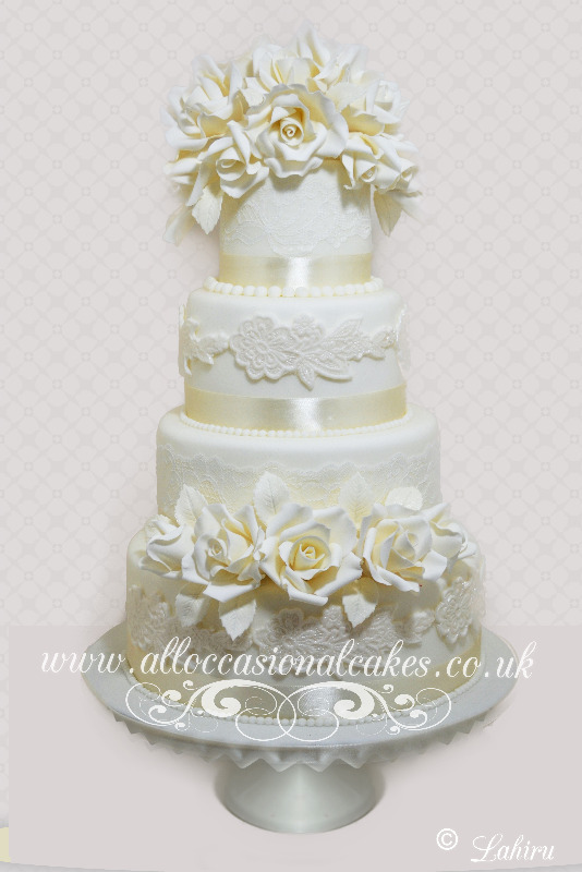 Double Bunch Ivory Spring Flora Wedding Cake, bristol wedding cakes, cakes pictures, magic wedding cakes,  uk cakes, uk wedding cakes, emersons green wedding cakes, cheap cakes, best cakes, international wedding cakes, international cakes, egg free cakes, egg less cakes, downend cakes, king cakes, downend wedding cakes, colourful cakes, all occasional cakes, cakes for all occasions, tasty wedding cakes, golden wedding cakes, sweet wedding cakes, anniversary cakes, sri lankan wedding,  wedding cakes, england wedding cakes, england cakes, birthday cakes, google cakes, winter cakes, snow cakes, topsy turvy cakes, cascade, cheap cakes, cheap wedding cakes, special wedding cakes, best cakes, uk, cakes, cake, cake makers, weddings, wedding, bristol, bristoluk, bath, bathuk, novelty cake, novelty cakes, unique cake, unique cakes, custom cake, custom cakes, birthday cake, birthday cakes, wedding cake, wedding cakes, corporate cake, corporate cakes, winning wedding cakes, winning cakes, yate wedding cakes, filton wedding cakes, clifton wedding cakes, winterbourne wedding cakes, London wedding cakes, royal wedding cakes, bristol wedding cakes, wedding cakes Bristol, wedding cake Bristol, Asian wedding cakes, indian wedding cakes, expensive cakes, expensive wedding cakes, rich wedding cakes, royal wedding cakes, rich cakes, gold wedding cakes, 24k wedding cakes, tasty wedding cakes, royal wedding cakes, queen wedding cakes, queen birthday cake, king's wedding cakes, Kings birthday cakes, prince wedding cakes, prince birthday cakes, best cakes, love cake, magic cakes, cake, fairy cakes, hot cakes, cupcakes, cupcake cakes, fondant cakes, cupcakes, my ace cakes of uk, cakes Sri Lanka, fab cakes, cakes sri lanka, south Gloucestershire, cake decoration, catering for weddings, Lahiru Peiris,