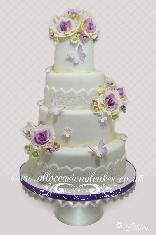 Lilac Themed Flowers and Bow, bristol wedding cakes, cakes pictures, magic wedding cakes,  uk cakes, uk wedding cakes, emersons green wedding cakes, cheap cakes, best cakes, international wedding cakes, international cakes, egg free cakes, egg less cakes, downend cakes, king cakes, downend wedding cakes, colourful cakes, all occasional cakes, cakes for all occasions, tasty wedding cakes, golden wedding cakes, sweet wedding cakes, anniversary cakes, sri lankan wedding,  wedding cakes, england wedding cakes, england cakes, birthday cakes, google cakes, winter cakes, snow cakes, topsy turvy cakes, cascade, cheap cakes, cheap wedding cakes, special wedding cakes, best cakes, uk, cakes, cake, cake makers, weddings, wedding, bristol, bristoluk, bath, bathuk, novelty cake, novelty cakes, unique cake, unique cakes, custom cake, custom cakes, birthday cake, birthday cakes, wedding cake, wedding cakes, corporate cake, corporate cakes, winning wedding cakes, winning cakes, yate wedding cakes, filton wedding cakes, clifton wedding cakes, winterbourne wedding cakes, London wedding cakes, royal wedding cakes, bristol wedding cakes, wedding cakes Bristol, wedding cake Bristol, Asian wedding cakes, indian wedding cakes, expensive cakes, expensive wedding cakes, rich wedding cakes, royal wedding cakes, rich cakes, gold wedding cakes, 24k wedding cakes, tasty wedding cakes, royal wedding cakes, queen wedding cakes, queen birthday cake, king's wedding cakes, Kings birthday cakes, prince wedding cakes, prince birthday cakes, best cakes, love cake, magic cakes, cake, fairy cakes, hot cakes, cupcakes, cupcake cakes, fondant cakes, cupcakes, my ace cakes of uk, cakes Sri Lanka, fab cakes, cakes sri lanka, south Gloucestershire, cake decoration, catering for weddings, Lahiru Peiris,