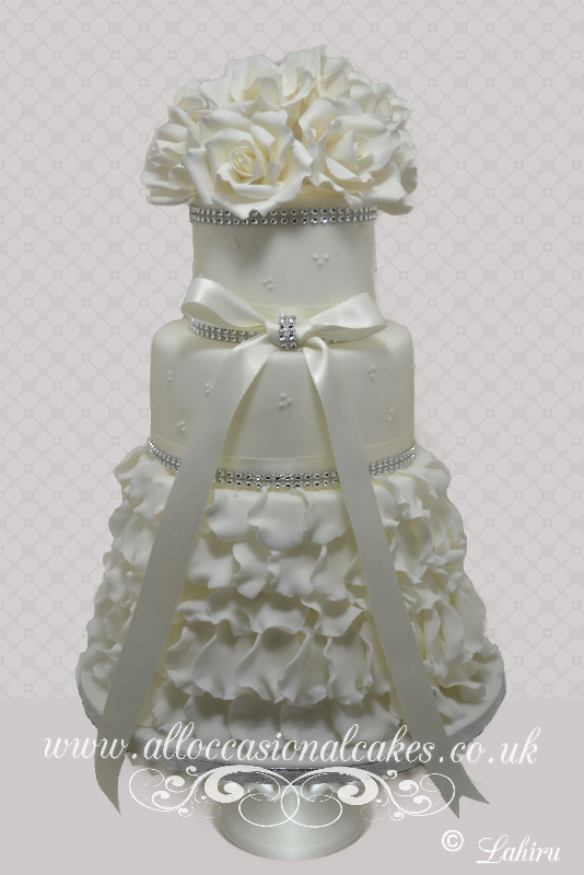 Ivory Themed Ruffle and Bow Wedding Cake, bristol wedding cakes, cakes pictures, magic wedding cakes,  uk cakes, uk wedding cakes, emersons green wedding cakes, cheap cakes, best cakes, international wedding cakes, international cakes, egg free cakes, egg less cakes, downend cakes, king cakes, downend wedding cakes, colourful cakes, all occasional cakes, cakes for all occasions, tasty wedding cakes, golden wedding cakes, sweet wedding cakes, anniversary cakes, sri lankan wedding,  wedding cakes, england wedding cakes, england cakes, birthday cakes, google cakes, winter cakes, snow cakes, topsy turvy cakes, cascade, cheap cakes, cheap wedding cakes, special wedding cakes, best cakes, uk, cakes, cake, cake makers, weddings, wedding, bristol, bristoluk, bath, bathuk, novelty cake, novelty cakes, unique cake, unique cakes, custom cake, custom cakes, birthday cake, birthday cakes, wedding cake, wedding cakes, corporate cake, corporate cakes, winning wedding cakes, winning cakes, yate wedding cakes, filton wedding cakes, clifton wedding cakes, winterbourne wedding cakes, London wedding cakes, royal wedding cakes, bristol wedding cakes, wedding cakes Bristol, wedding cake Bristol, Asian wedding cakes, indian wedding cakes, expensive cakes, expensive wedding cakes, rich wedding cakes, royal wedding cakes, rich cakes, gold wedding cakes, 24k wedding cakes, tasty wedding cakes, royal wedding cakes, queen wedding cakes, queen birthday cake, king's wedding cakes, Kings birthday cakes, prince wedding cakes, prince birthday cakes, best cakes, love cake, magic cakes, cake, fairy cakes, hot cakes, cupcakes, cupcake cakes, fondant cakes, cupcakes, my ace cakes of uk, cakes Sri Lanka, fab cakes, cakes sri lanka, south Gloucestershire, cake decoration, catering for weddings, Lahiru Peiris,