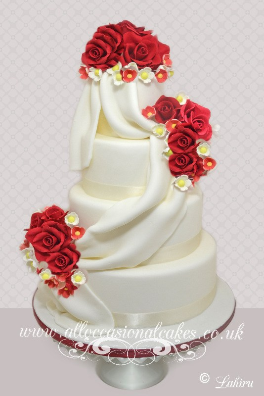 Sugar Drap and Red Floral Spray Wedding Cake