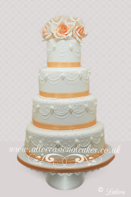 Stylish Orange Wedding Cake, bristol wedding cakes, cakes pictures, magic wedding cakes,  uk cakes, uk wedding cakes, emersons green wedding cakes, cheap cakes, best cakes, international wedding cakes, international cakes, egg free cakes, egg less cakes, downend cakes, king cakes, downend wedding cakes, colourful cakes, all occasional cakes, cakes for all occasions, tasty wedding cakes, golden wedding cakes, sweet wedding cakes, anniversary cakes, sri lankan wedding,  wedding cakes, england wedding cakes, england cakes, birthday cakes, google cakes, winter cakes, snow cakes, topsy turvy cakes, cascade, cheap cakes, cheap wedding cakes, special wedding cakes, best cakes, uk, cakes, cake, cake makers, weddings, wedding, bristol, bristoluk, bath, bathuk, novelty cake, novelty cakes, unique cake, unique cakes, custom cake, custom cakes, birthday cake, birthday cakes, wedding cake, wedding cakes, corporate cake, corporate cakes, winning wedding cakes, winning cakes, yate wedding cakes, filton wedding cakes, clifton wedding cakes, winterbourne wedding cakes, London wedding cakes, royal wedding cakes, bristol wedding cakes, wedding cakes Bristol, wedding cake Bristol, Asian wedding cakes, indian wedding cakes, expensive cakes, expensive wedding cakes, rich wedding cakes, royal wedding cakes, rich cakes, gold wedding cakes, 24k wedding cakes, tasty wedding cakes, royal wedding cakes, queen wedding cakes, queen birthday cake, king's wedding cakes, Kings birthday cakes, prince wedding cakes, prince birthday cakes, best cakes, love cake, magic cakes, cake, fairy cakes, hot cakes, cupcakes, cupcake cakes, fondant cakes, cupcakes, my ace cakes of uk, cakes Sri Lanka, fab cakes, cakes sri lanka, south Gloucestershire, cake decoration, catering for weddings, Lahiru Peiris,