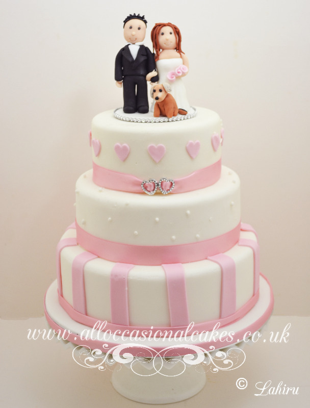 Pink stripes with topper wedding cake bristol
