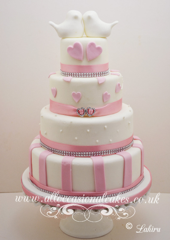 Pink Hearts Wedding Cake With Topper, bristol wedding cakes, cakes pictures, magic wedding cakes,  uk cakes, uk wedding cakes, emersons green wedding cakes, cheap cakes, best cakes, international wedding cakes, international cakes, egg free cakes, egg less cakes, downend cakes, king cakes, downend wedding cakes, colourful cakes, all occasional cakes, cakes for all occasions, tasty wedding cakes, golden wedding cakes, sweet wedding cakes, anniversary cakes, sri lankan wedding,  wedding cakes, england wedding cakes, england cakes, birthday cakes, google cakes, winter cakes, snow cakes, topsy turvy cakes, cascade, cheap cakes, cheap wedding cakes, special wedding cakes, best cakes, uk, cakes, cake, cake makers, weddings, wedding, bristol, bristoluk, bath, bathuk, novelty cake, novelty cakes, unique cake, unique cakes, custom cake, custom cakes, birthday cake, birthday cakes, wedding cake, wedding cakes, corporate cake, corporate cakes, winning wedding cakes, winning cakes, yate wedding cakes, filton wedding cakes, clifton wedding cakes, winterbourne wedding cakes, London wedding cakes, royal wedding cakes, bristol wedding cakes, wedding cakes Bristol, wedding cake Bristol, Asian wedding cakes, indian wedding cakes, expensive cakes, expensive wedding cakes, rich wedding cakes, royal wedding cakes, rich cakes, gold wedding cakes, 24k wedding cakes, tasty wedding cakes, royal wedding cakes, queen wedding cakes, queen birthday cake, king's wedding cakes, Kings birthday cakes, prince wedding cakes, prince birthday cakes, best cakes, love cake, magic cakes, cake, fairy cakes, hot cakes, cupcakes, cupcake cakes, fondant cakes, cupcakes, my ace cakes of uk, cakes Sri Lanka, fab cakes, cakes sri lanka, south Gloucestershire, cake decoration, catering for weddings, Bristol birthday cakes, Bristol anniversary cakes, Kids birthday cakes Bristol, adult birthday cakes Bristol, cheap birthday cakes Bristol,  Asian cakes Bristol, Asian wedding cakes Bristol, indian wedding cake cakes Bristol indian cake bristol, cupcake Bristol, Santa cakes Bristol, seasonal cakes Bristol, hand bag cakes Bristol, indian cream cake Bristol, egg free wedding cakes Bristol, eggless cakes cake Bristol, Christmas cakes Bristol, car cakes Bristol, Lamborghini cakes Bristol, Bristol, piers, call piers, the art of sweet wedding cakes Bristol, boys birthday cakes Bristol, girls birthday cake bristol, emersons green birthday cakes, emersons green anniversary cakes, Kids birthday cakes emersons green, adult birthday cakes emersons green, cheap birthday cakes emersons green,  Asian cakes emersons green, Asian wedding cakes emersons green, indian wedding cake cakes emersons green indian cake emersons green, cupcake emersons green, Santa cakes emersons green, seasonal cakes emersons green, hand bag cakes emersons green, indian cream cake emersons green, egg free wedding cakes emersons green, eggless cakes cake emersons green, Christmas cakes emersons green, car cakes emersons green, Lamborghini cakes emersons green, emersons green, piers, call piers, the art of sweet wedding cakes emersons green, boys birthday cakes emersons green, girls birthday cake emersons green, downend birthday cakes, downend anniversary cakes, Kids birthday cakes downend, adult birthday cakes downend, cheap birthday cakes downend, Asian cakes downend, Asian wedding cakes downend, indian wedding cake cakes downend, indian cake downend, cupcake downend, Santa cakes downend, seasonal cakes downend, hand bag cakes downend, indian cream cake downend, egg free wedding cakes downend, eggless cakes cake downend, Christmas cakes downend, car cakes downend, Lamborghini cakes downend, downend, piers, call piers, the art of sweet wedding cakes downend, boys birthday cakes downend, girls birthday cake downend, Lahiru Peiris,