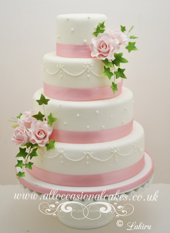 Pink rose with piping stylish wedding cake Bristol