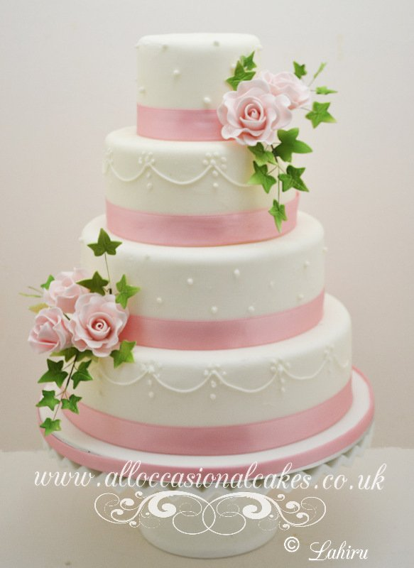 Pink Rose With Sugar Piping Wedding Cake, bristol wedding cakes, cakes pictures, magic wedding cakes,  uk cakes, uk wedding cakes, emersons green wedding cakes, cheap cakes, best cakes, international wedding cakes, international cakes, egg free cakes, egg less cakes, downend cakes, king cakes, downend wedding cakes, colourful cakes, all occasional cakes, cakes for all occasions, tasty wedding cakes, golden wedding cakes, sweet wedding cakes, anniversary cakes, sri lankan wedding,  wedding cakes, england wedding cakes, england cakes, birthday cakes, google cakes, winter cakes, snow cakes, topsy turvy cakes, cascade, cheap cakes, cheap wedding cakes, special wedding cakes, best cakes, uk, cakes, cake, cake makers, weddings, wedding, bristol, bristoluk, bath, bathuk, novelty cake, novelty cakes, unique cake, unique cakes, custom cake, custom cakes, birthday cake, birthday cakes, wedding cake, wedding cakes, corporate cake, corporate cakes, winning wedding cakes, winning cakes, yate wedding cakes, filton wedding cakes, clifton wedding cakes, winterbourne wedding cakes, London wedding cakes, royal wedding cakes, bristol wedding cakes, wedding cakes Bristol, wedding cake Bristol, Asian wedding cakes, indian wedding cakes, expensive cakes, expensive wedding cakes, rich wedding cakes, royal wedding cakes, rich cakes, gold wedding cakes, 24k wedding cakes, tasty wedding cakes, royal wedding cakes, queen wedding cakes, queen birthday cake, king's wedding cakes, Kings birthday cakes, prince wedding cakes, prince birthday cakes, best cakes, love cake, magic cakes, cake, fairy cakes, hot cakes, cupcakes, cupcake cakes, fondant cakes, cupcakes, my ace cakes of uk, cakes Sri Lanka, fab cakes, cakes sri lanka, south Gloucestershire, cake decoration, catering for weddings, Bristol birthday cakes, Bristol anniversary cakes, Kids birthday cakes Bristol, adult birthday cakes Bristol, cheap birthday cakes Bristol,  Asian cakes Bristol, Asian wedding cakes Bristol, indian wedding cake cakes Bristol indian cake bristol, cupcake Bristol, Santa cakes Bristol, seasonal cakes Bristol, hand bag cakes Bristol, indian cream cake Bristol, egg free wedding cakes Bristol, eggless cakes cake Bristol, Christmas cakes Bristol, car cakes Bristol, Lamborghini cakes Bristol, Bristol, piers, call piers, the art of sweet wedding cakes Bristol, boys birthday cakes Bristol, girls birthday cake bristol, emersons green birthday cakes, emersons green anniversary cakes, Kids birthday cakes emersons green, adult birthday cakes emersons green, cheap birthday cakes emersons green,  Asian cakes emersons green, Asian wedding cakes emersons green, indian wedding cake cakes emersons green indian cake emersons green, cupcake emersons green, Santa cakes emersons green, seasonal cakes emersons green, hand bag cakes emersons green, indian cream cake emersons green, egg free wedding cakes emersons green, eggless cakes cake emersons green, Christmas cakes emersons green, car cakes emersons green, Lamborghini cakes emersons green, emersons green, piers, call piers, the art of sweet wedding cakes emersons green, boys birthday cakes emersons green, girls birthday cake emersons green, downend birthday cakes, downend anniversary cakes, Kids birthday cakes downend, adult birthday cakes downend, cheap birthday cakes downend, Asian cakes downend, Asian wedding cakes downend, indian wedding cake cakes downend, indian cake downend, cupcake downend, Santa cakes downend, seasonal cakes downend, hand bag cakes downend, indian cream cake downend, egg free wedding cakes downend, eggless cakes cake downend, Christmas cakes downend, car cakes downend, Lamborghini cakes downend, downend, piers, call piers, the art of sweet wedding cakes downend, boys birthday cakes downend, girls birthday cake downend, Lahiru Peiris,