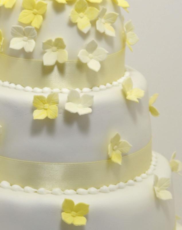 yellow hydrangea cascade wedding cake 1