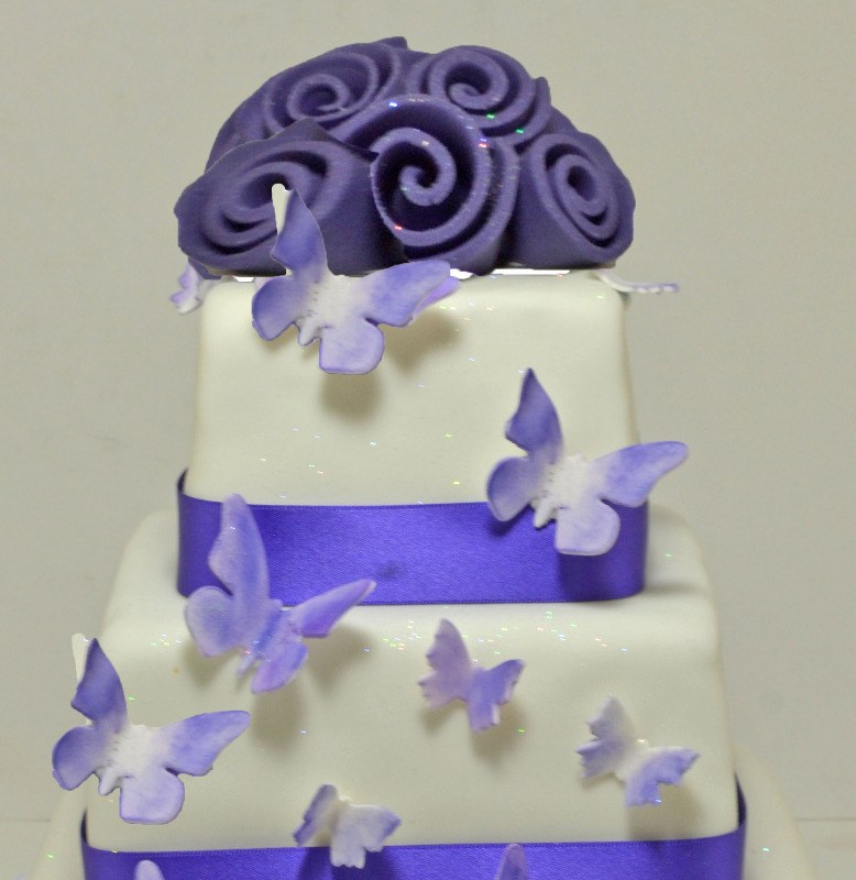cadbury purple butterfly cascade wedding cake 1
