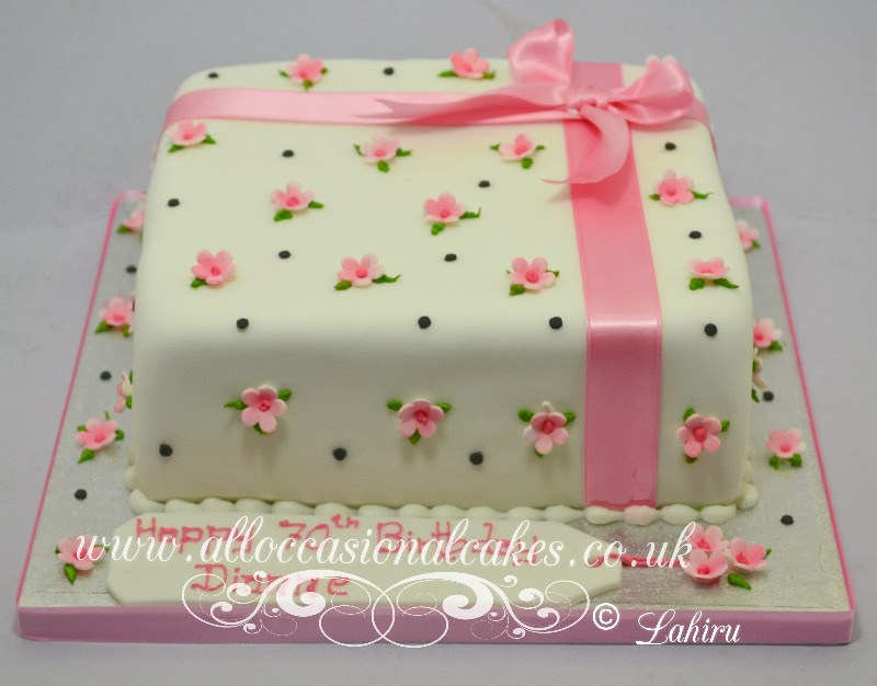 pink forget me not present cake