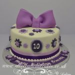 lilac bow with flower petals birthday cake