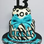 zebra print with blue bow birthday  cake