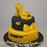 gold shoe and bow cake