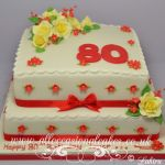 red and yellow 80th birthday cake