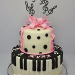 pink bow with music notes cake