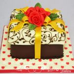 gold ribbon with red rose parcel cake