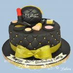 black and gold makeup cake