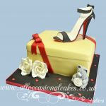 designer red and black high heel on the shoe box cake
