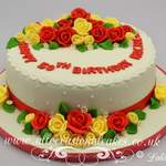 red and yellow roses birthday cake
