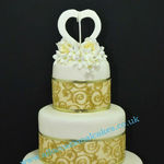 golden themed wedding anniversary cake