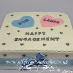 blue and pink heart engagement cake