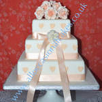 peach roses with hearts 3 tier from  £ 220