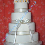 Simple wedding cake with daisies 4 tier £290