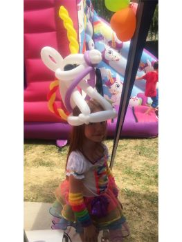 girl wearing unicorn balloon