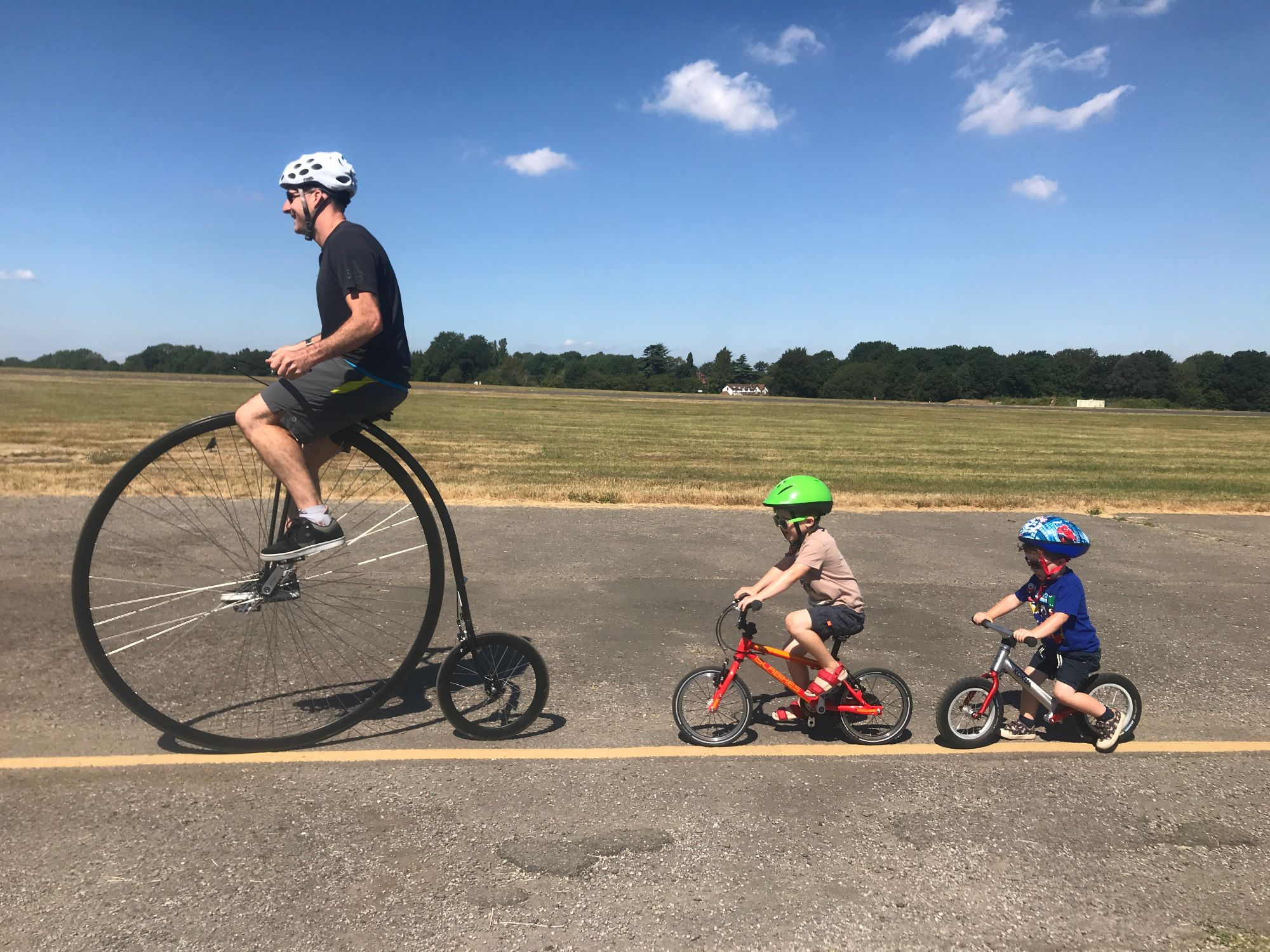 Penny Farthing with the boys on bikes