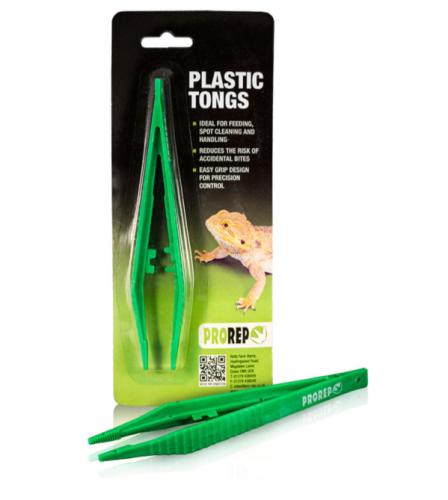 Small green plastic feeding tongs