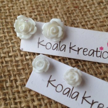 Rose stud earrings white