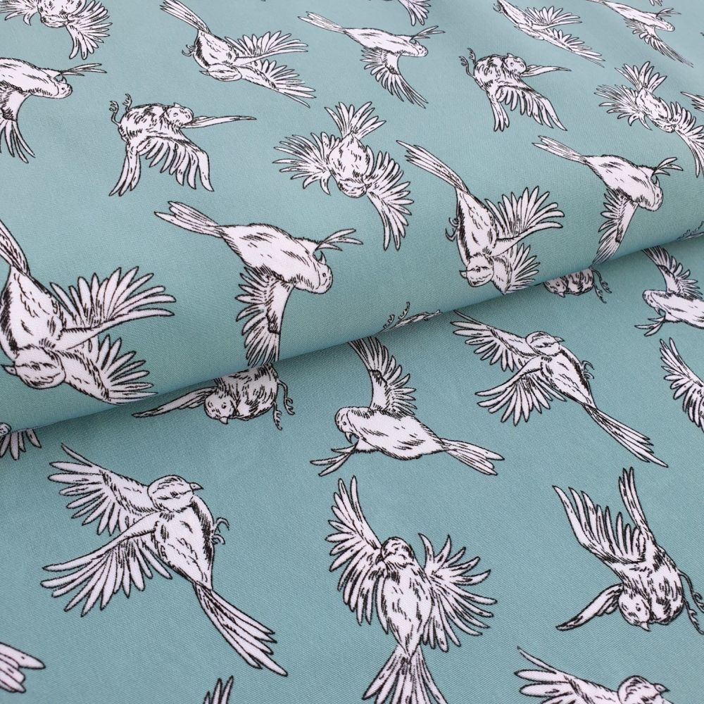 Birds on Green Micro Satin Fabric