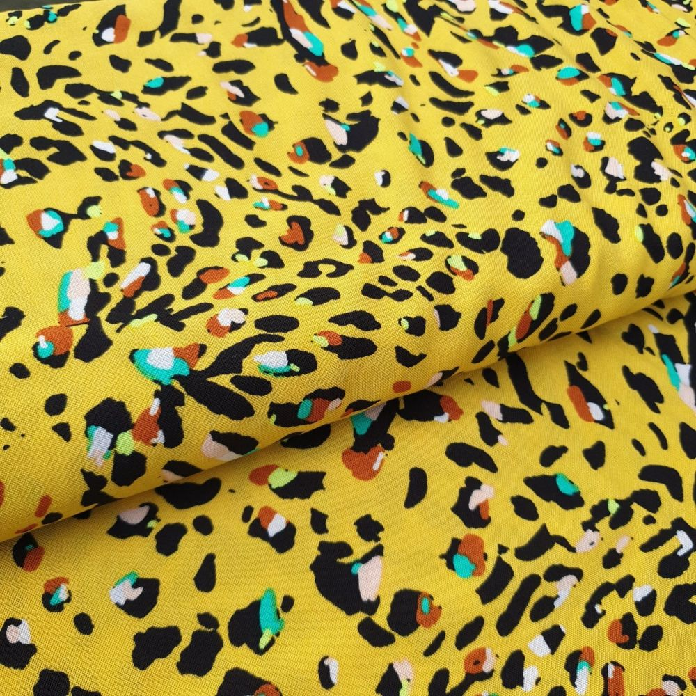Leopard on Mustard Viscose fabric